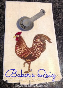 teaspoons on a tea towel with a rooster