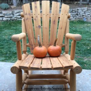 two pumpkins in a chair
